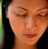 woman with her eyes closed, quietly meditating, Shen Men Feng Shui